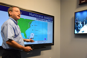 A forecaster with the National Hurricane Center in Miami briefs FEMA about the track forecast for Hurricane Joaquin in 2015
