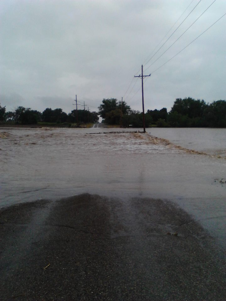 Photo of flooded roadway near Roswell, NM. Image by Amy Cook.