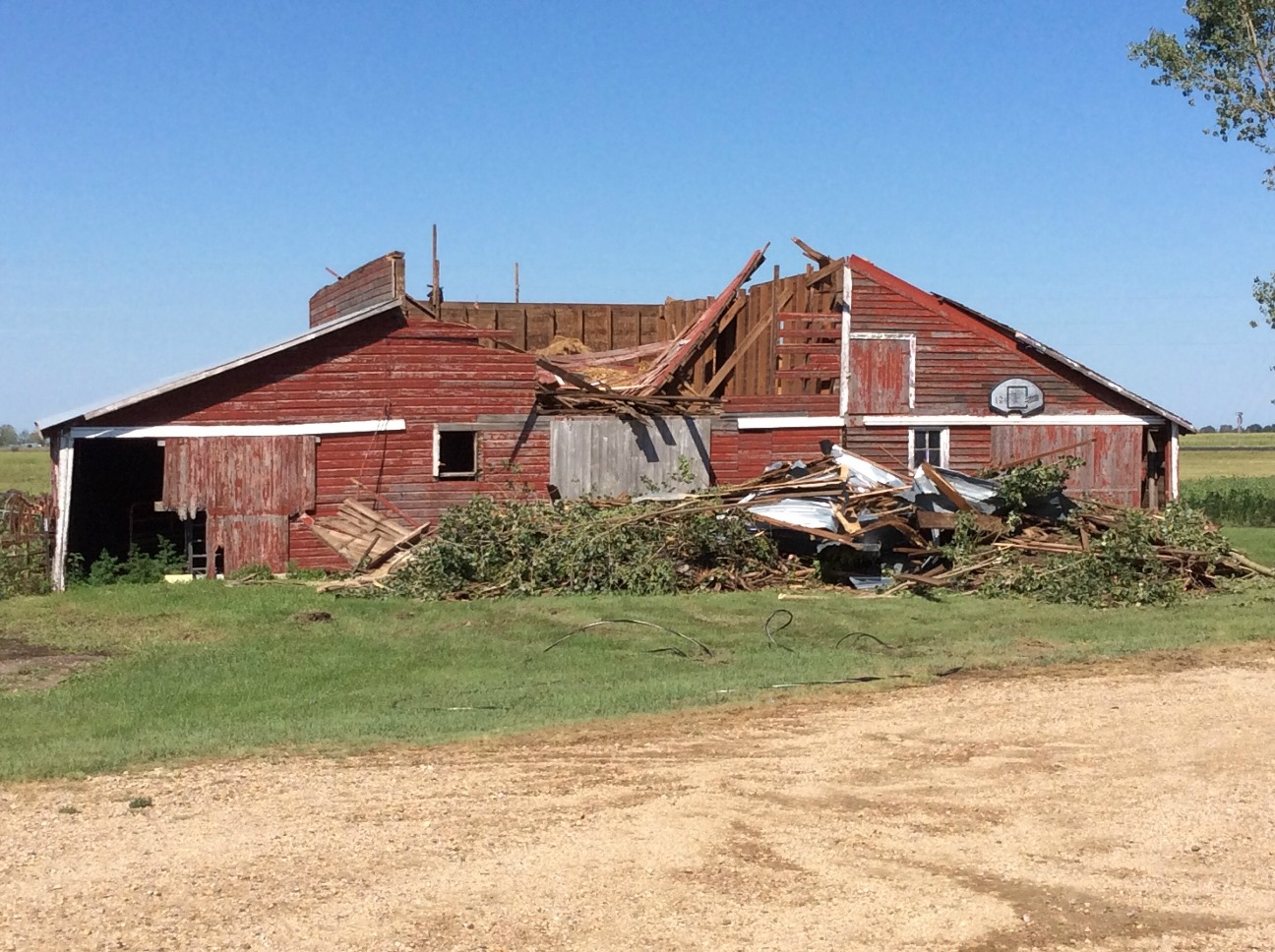 Damage to a barn located 1 mile east of Andover