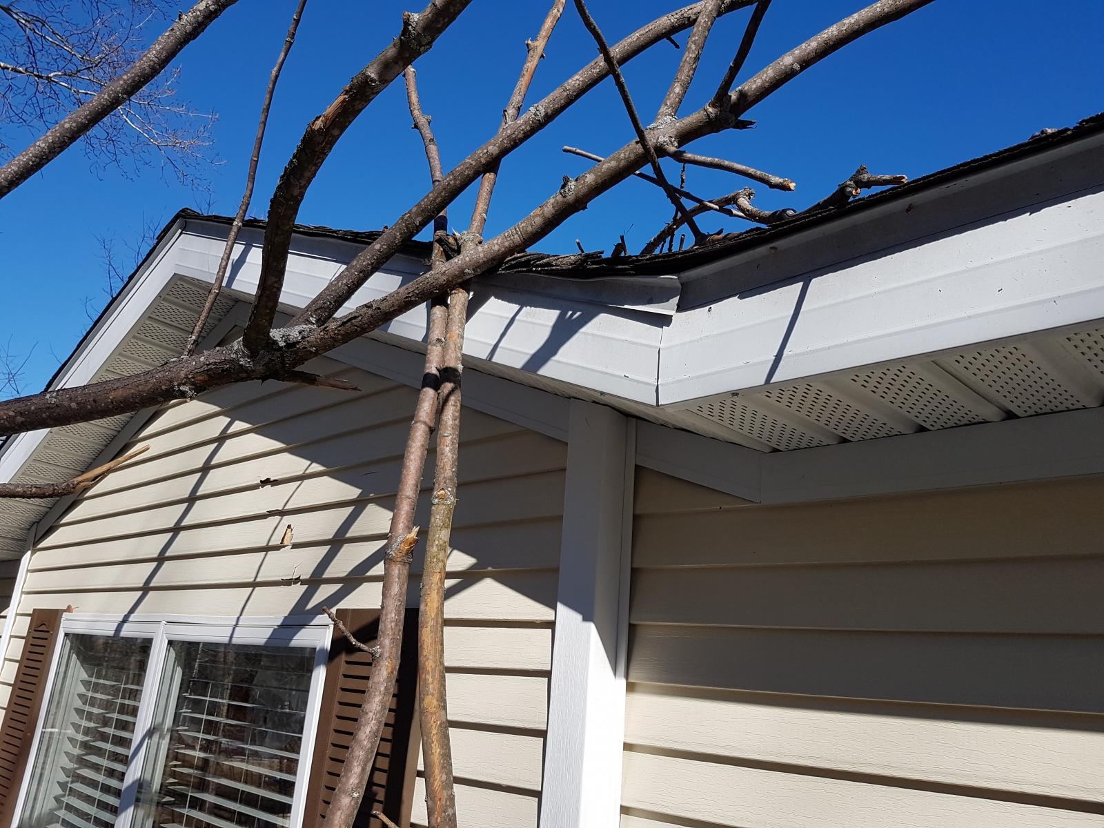 Tim Willson damage to house from strong winds - East Jordan