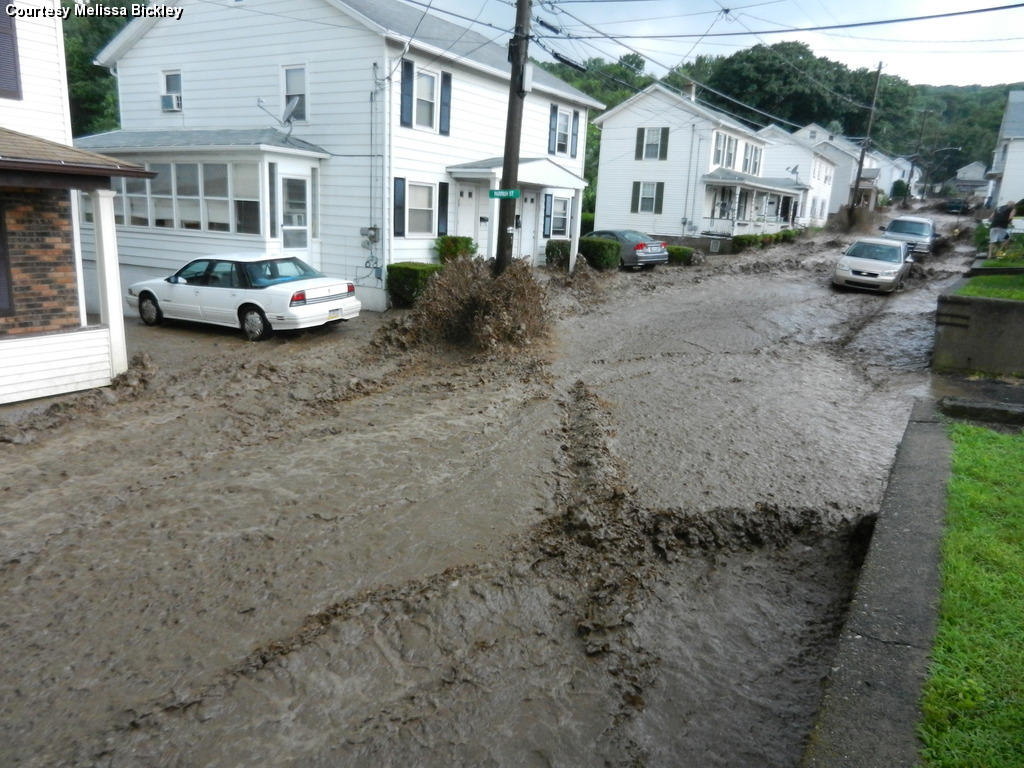 Fast moving water around cars and power poles on Coal Street, Plymouth, PA