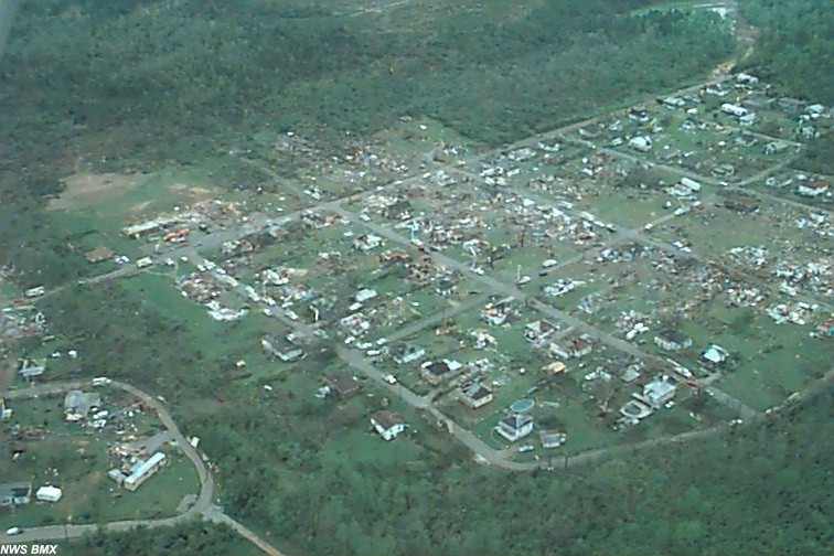 Tornado damage shown from above just west of the Oak Grove High School.