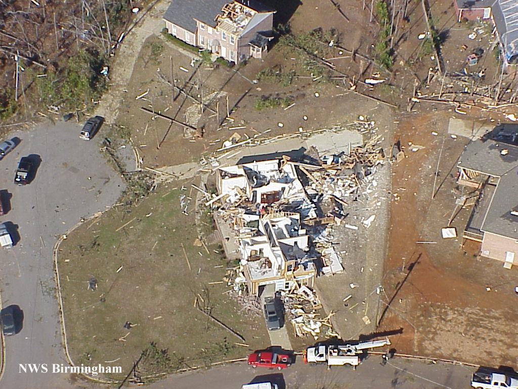 Damage to houses.  Damage to house in the center of image is F3.