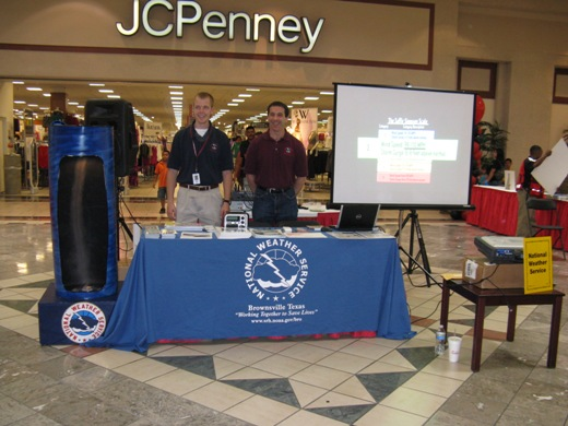 Budding Forecaster Rob Hart and Warning Coordination Meteorologist Barry Goldsmith at NWS Brownsville booth, La Plaza Mall Hurricane Expo 2009