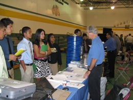 Forecaster Buddy Martin explaining the jobs performed at the NWS office in Brownsville to senior high school students in Lyford, TX, May 2009 (Click for larger image)