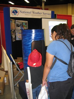 A mother and son check out the NWS Brownsville tornado chamber at the Hidalgo County Disaster Readiness Expo, McAllen