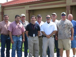 Warning Coordination Meteorologist Barry Goldsmith (center) posing with agricultural and hunting instructors from Texas Parks and Wildlife, June, 2009 (Click for larger image)