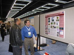 Mike Castillo, Forecaster at NWS Brownsville/Rio Grande Valley, answering questions from visitor to poster session on Rio Grande Flood of 2010 (click to enlarge)
