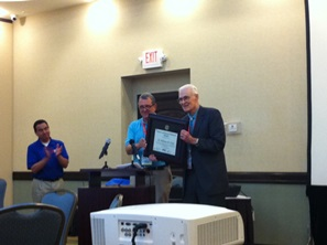 Dr. Bill Gray receiving the First Robert and Joanne Simpson Award for Outstanding Contributions to  Tropical Meteorology