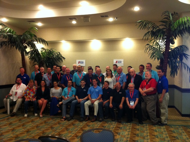 Group photo of primarily television and print broadcast meteorologists and other attendees at the 2014 Second National Tropical Weather Conference