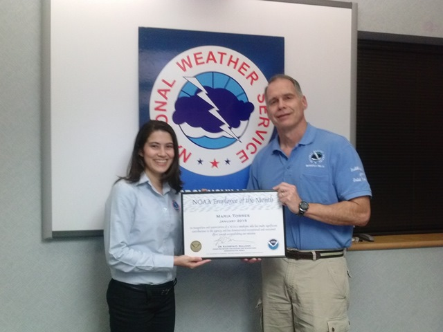 NWS Brownsville/Rio Grande Valley Forecaster Maria Torres (right) received NOAA Employee of the Month Certificate for January 2015 from Steve Drillette, Meteorologist-in-Charge