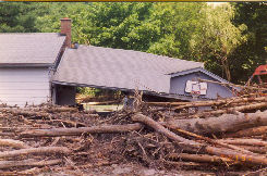 house with flood damage and debris