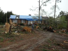 Photo of tornado damage to a house.