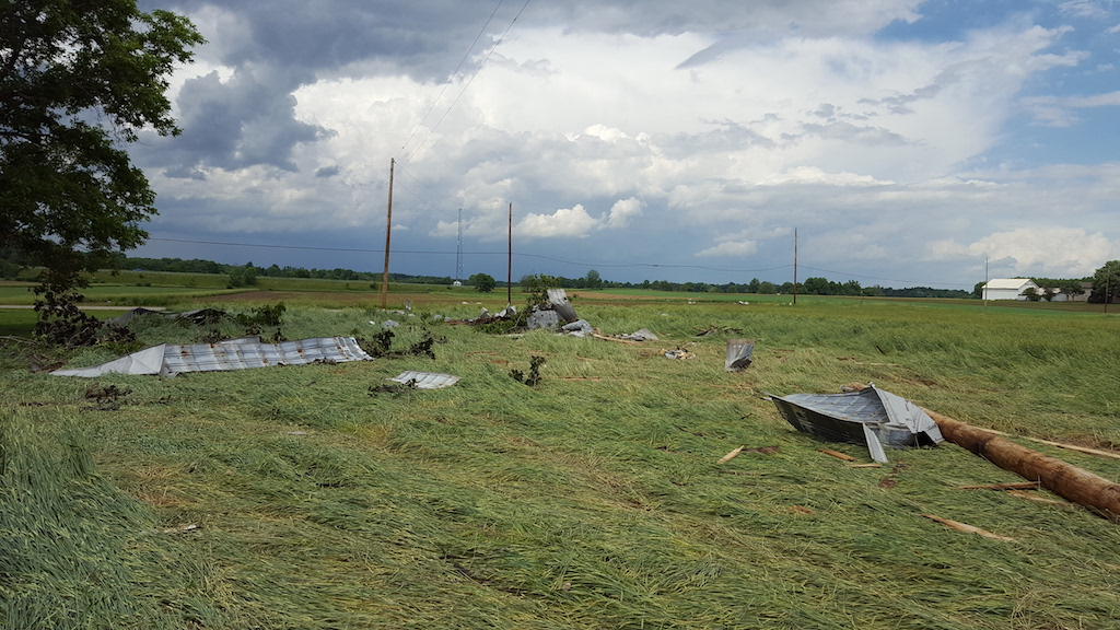Sheet Metal in a Field Off of a Roof of a Barn in Wayne County due to a Microburst