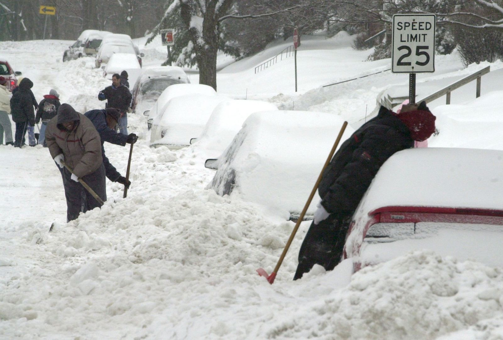 Motorists digging their cars out of deep snow