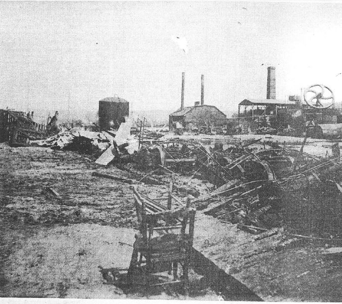 Image of one of several burned oil refineries in Titusville after the fire and floods of June 4-5, 1892.