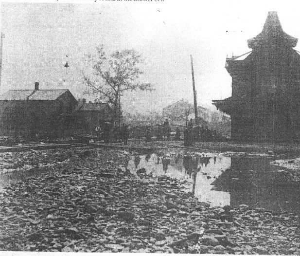 Image of severely damaged train depot in Titusville after the flood and fires of June 5 1892.