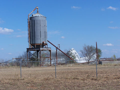 Empty silo damaged by the wind