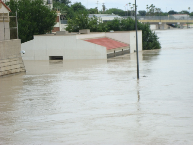 International Bridge dog kennel under water at crest