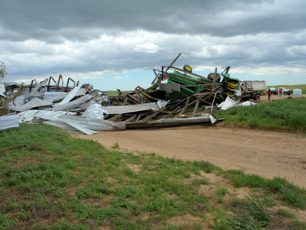 A large shed was destroyed and cotton pickers rolled in Edwards county