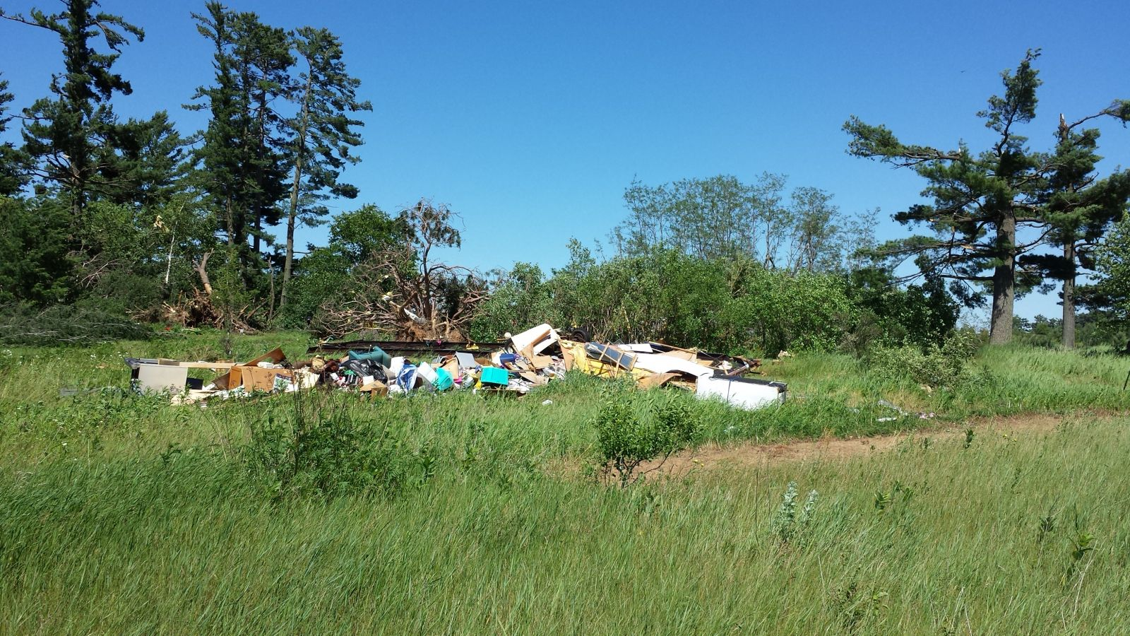 A manufactured home was destroyed 2.5 miles south of Deerwood, MN
