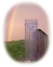 CoCoRaHS Image - Rainbow and Rain Gauge