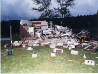 [ damage to a home by tornado spawned by Ivan ]
