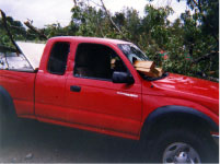 [ Damage to truck caused by tornado spawned by Ivan ]
