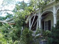 [ Downed tree damages home ]