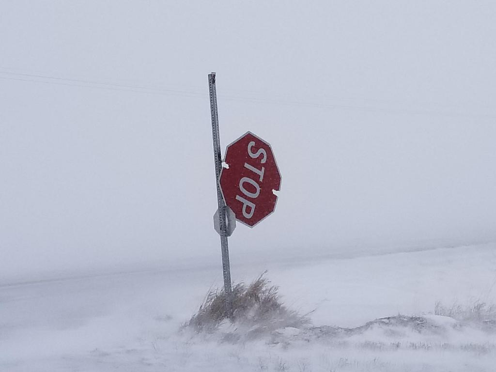 Stop Sign north of Terril Iowa, ripped from pole by strong winds