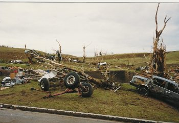 Picture of the Don and Debbie Buys residence after the tornado moved through Chandler.  Taken 17 June 1992.