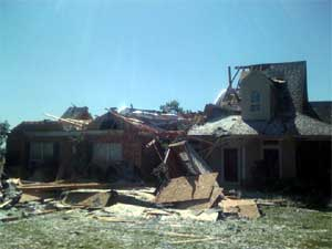 Picture of a home that was damaged by a tornado near Cash, Texas
