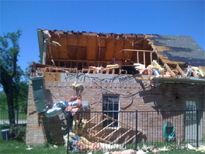 Picture of a home damaged near Forney, Texas.