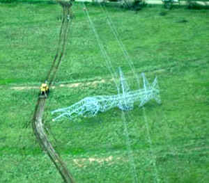 Damage to metal transmission line towers 1/2 mile west of Interstate 45:
