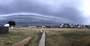 A picture of a storm approaching NWS Fort Worth with a large shelf cloud.