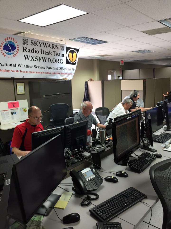 A picture of Amateur Radio operators working HAM radios at NWS Fort Worth.