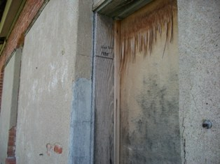 Close up of Door on Old Light and Power Building in Arapahoe, NE with High Water Mark
