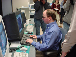 Lead forecaster Chris Darden finalizes work on the first Zone Forecast to be issued from Huntsville as several members of the local news media look on.