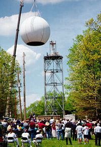 Onlookers watch as the dome is raised onto the new Hytop radar at a dedication ceremony in April 1997.