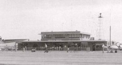 The Huntsville Airport bhad a new terminal building in the mid-1950s.  This image faintly shows the wind vane and anemometer on top of the building.