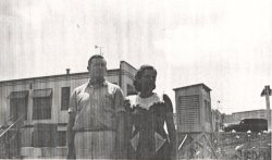 Joe and Ruby Cambron standing next to their Cotton Region shelter in August 1941.  The site's wind eqipment, directly behind them, is on top of the Texaco station they owned.