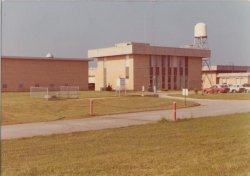 The National weather Service building at the Huntsville International Airport in the mid 1970s.  The WSR-3 radar can be seen next to the building, with rain gauges and an instrument shelter in front.