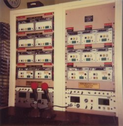 Broadcast equipment for KIH-20 Huntsville and KIH-57 Florence.  Broadcast segments would be recorded on tapes, whcih were inserted into tape decks seen here.