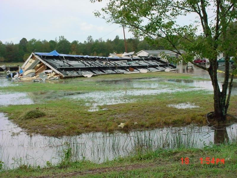Tornado damage of mobile home and water from flooding