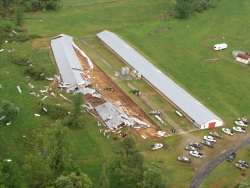 These chicken houses in northeastern Cullman County were destroyed by the tornado. The one on the left was blown apart. Though the one on the right may appear to be in tact, it was actually found to be structurally unsound. Image courtesy Cullman County EMA.