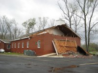 The front of this church sustained considerable damage in the tornado. The roof was damaged and, the steeple was blown off.