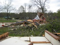 An unanchored building was destroyed, and several trees were downed