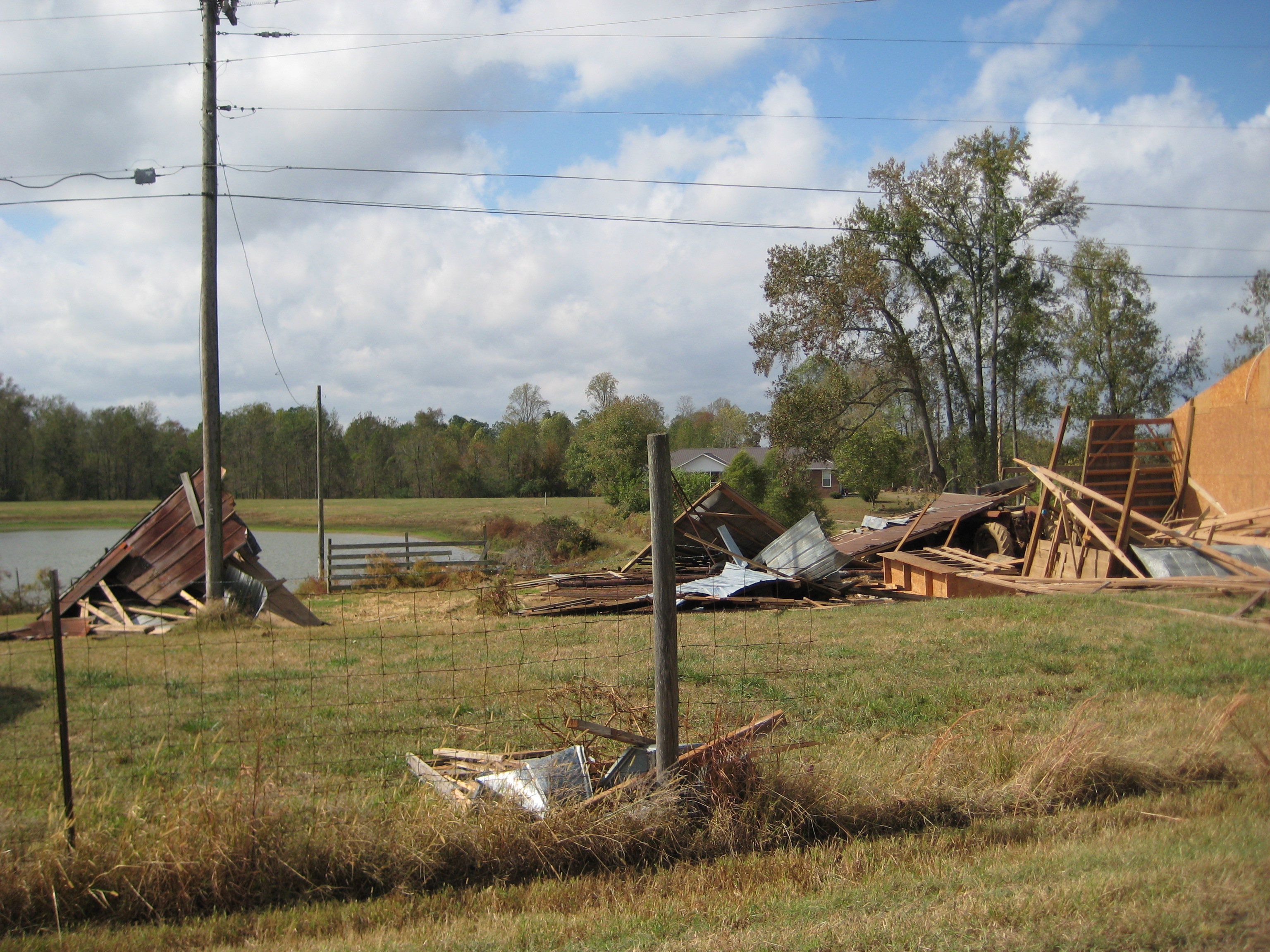 A portion of a barn destroyed along the path.
