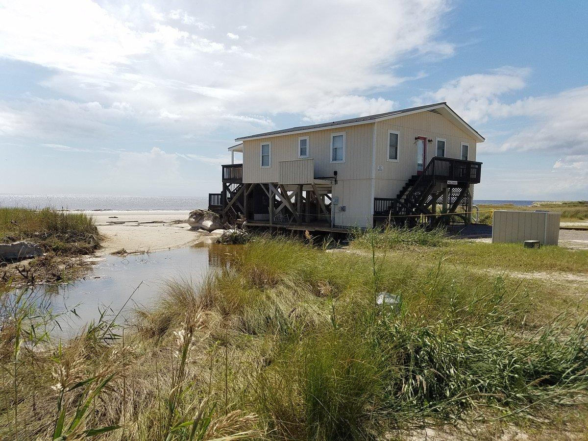 One of the few homes left on the beach side of East Beach Drive near SE 55th Avenue was undermined by waves from Hurricane Florence. (Photo credit: NWS)
