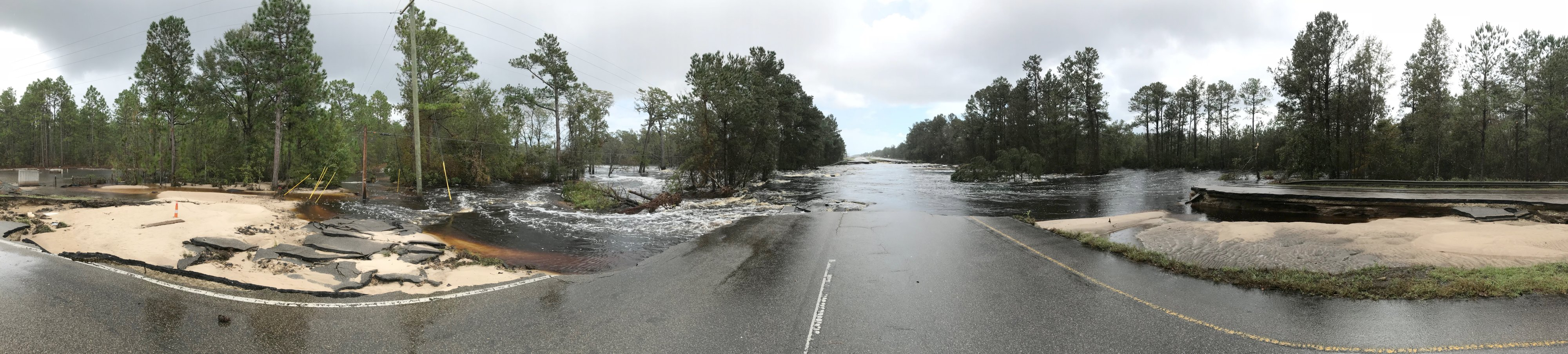 Panorama of the Highway 421 washout just north of Wilmington. The Cape Fear River scoured a path through the highway to reach the Northeast Cape Fear River channel off to the east. (Photo credit: Rick Neuherz/NWS)